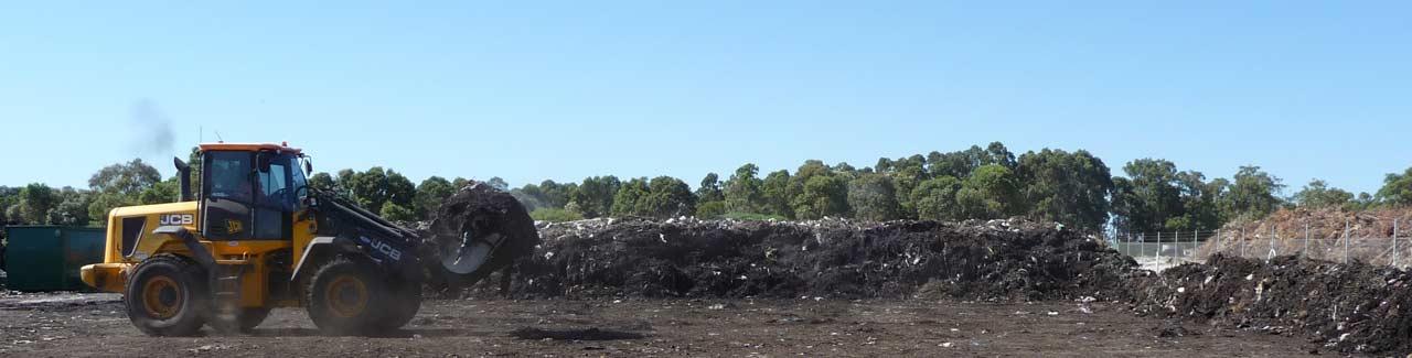 Loader turning compost